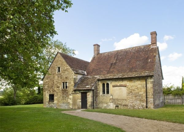FIDDLEFORD MANOR, Dorset. Exterior view. The principal parts of a small stone manor house, probably begun c.1370 for William Latimer, Sheriff of Somerset and Dorset