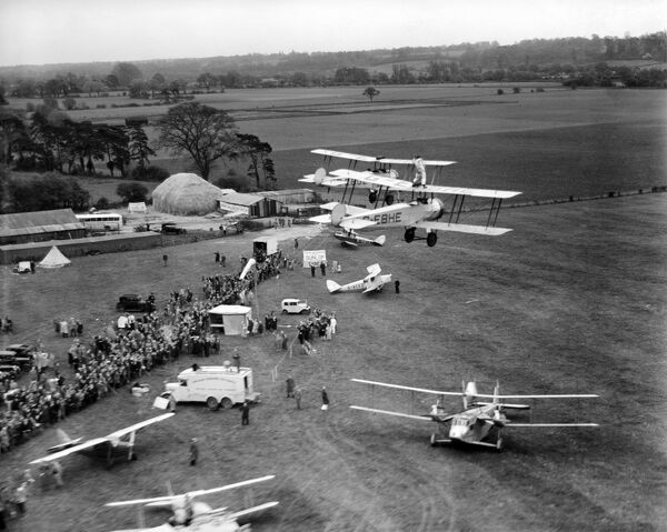 Flying circus, April 1933. Aviation events like this one were popular entertainments between the wars, including aerobatics, barnstorming and wing-walking (as seen here). In 1933 the UK Civil Aviation Authority banned wing-walking without a rigid harness
