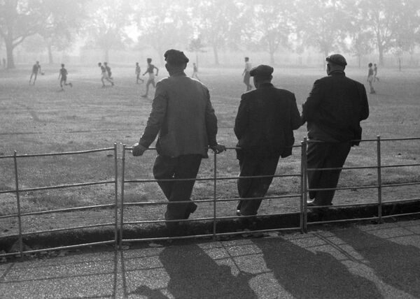 VICTORIA PARK, London. Spectators watching a football match in 1961. Laurence Goldman