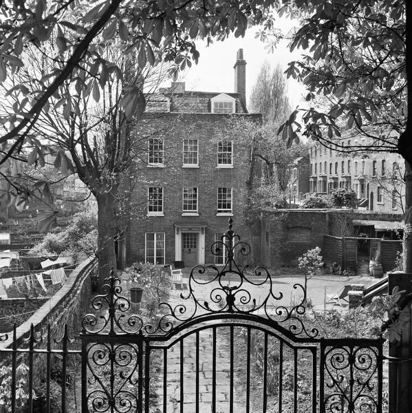 GARDNOR HOUSE, Hampstead, London. Looking over the ornate garden gateway and railings towards the front elevation of the house. Photographed by John Gay. Date range: 1960 - 1965
