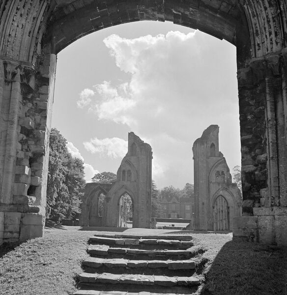 GLASTONBURY ABBEY, Glastonbury, Somerset. View of the two piers formerly supporting the choir arch at Glastonbury Abbey, seen from steps leading up from the Galilee in the Lady Chapel to the nave. Photographed by John Gay in April 1953