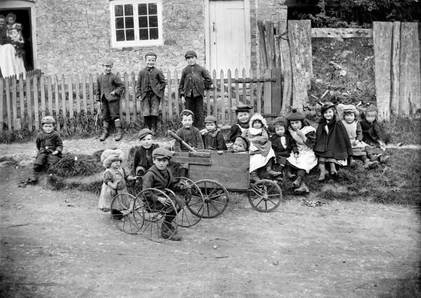 A group of children playing on home made Go-Karts at Greatworth, Northamptonshire. Photographed by Alfred Newton and Son in October 1901