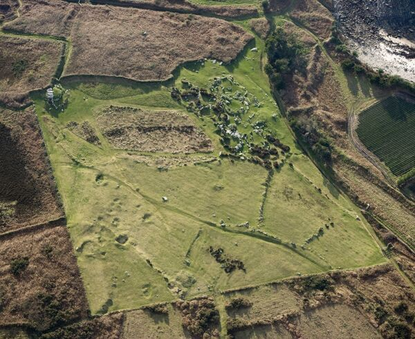 BANT'S CARN BURIAL CHAMBER and HALANGY DOWN ANCIENT VILLAGE, St Marys, Isles of Scilly. Aerial view