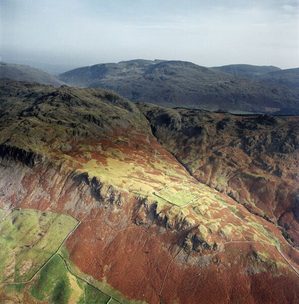 HARDKNOTT, Cumbria. Aerial photograph showing the well-placed Roman fort on a promontory overlooking the Lake District (NGR: NY218015). Aerofilms Collection (see Links)
