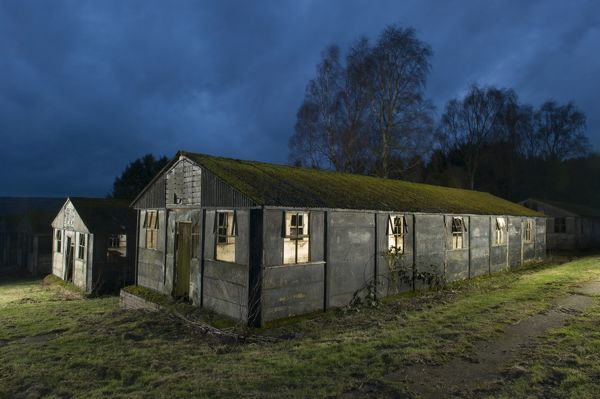 Harperley Prisoner of War Camp 93, Craigside, County Durham. Exterior of one of the huts, lit from within