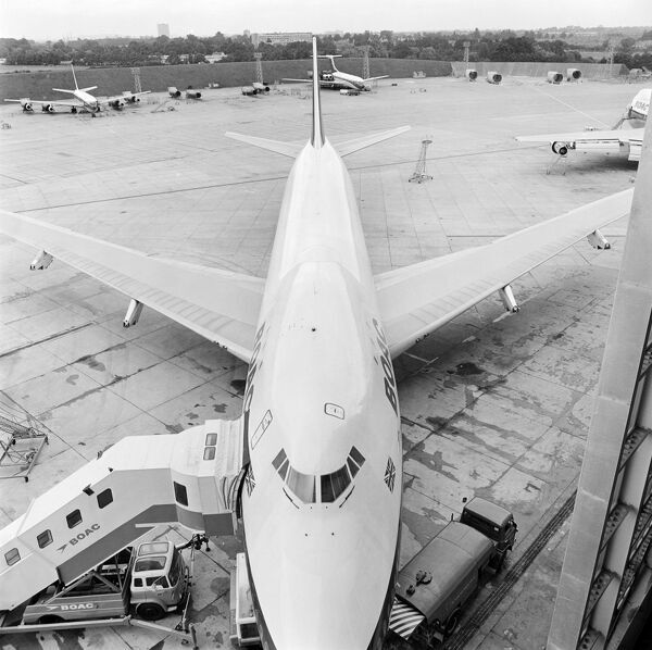 HEATHROW AIRPORT, Greater London. A BOAC aircraft with boarding steps to left at Heathrow Airport. Photograph by John Gay in 1970