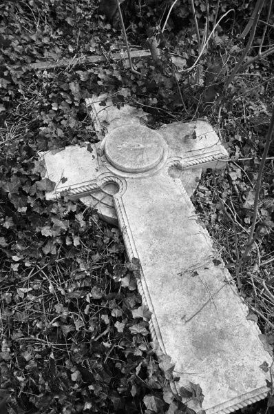 HIGHGATE CEMETERY, Hampstead, London. A Celtic cross tombstone, carved with a sundial, in the West Cemetery. Photographed by John Gay in March 1984