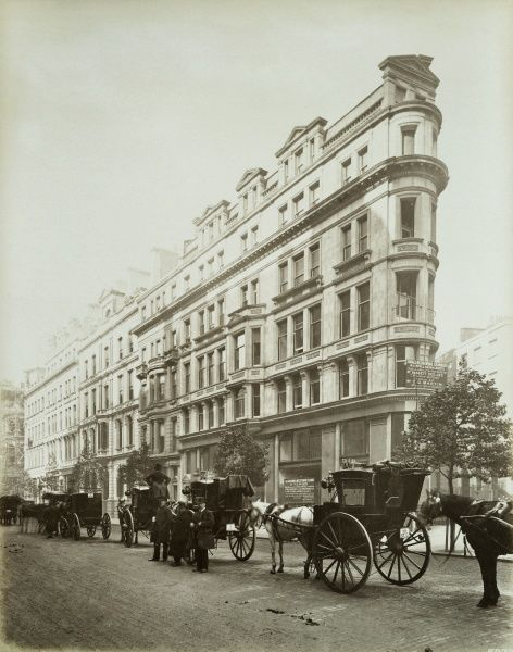 NORTHUMBERLAND AVENUE, Westminster, London. Perspective view of the exterior of a newly-built office block on Northumberland Avenue with a line of horse-drawn cabs waiting outside. Photographed in 1885 by Bedford Lemere
