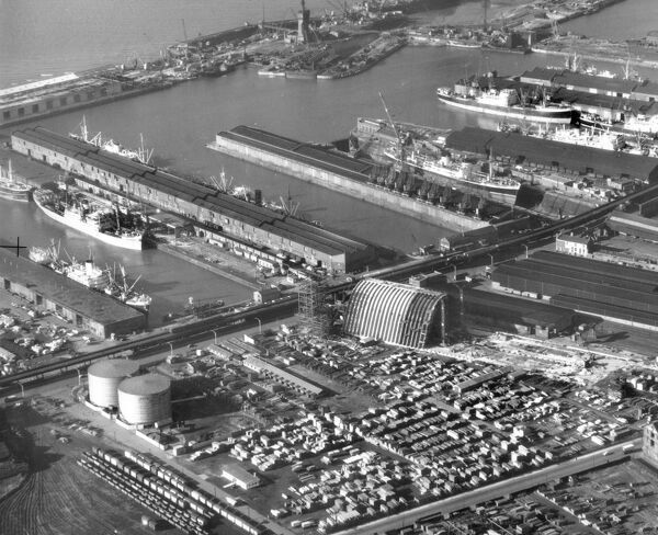 Huskisson Dock, Regent Road, Liverpool. An aerial view of the docks, with the Tate & Lyle sugar silo under construction near the centre of the picture. Photographed in November 1956 for Tate and Lyle - Tate and Lyle Collection