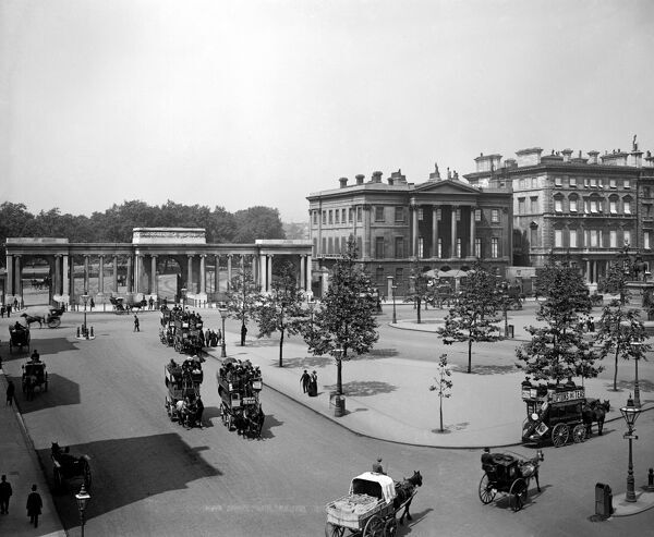 HYDE PARK CORNER, Westminster, London. Looking north towards the Hyde Park Corner screen (by Decimus Burton) and Apsley House (now the Wellington Museum). Apsley House is shown as the last in a line of buildings on Piccadilly - its neighbours have now gone