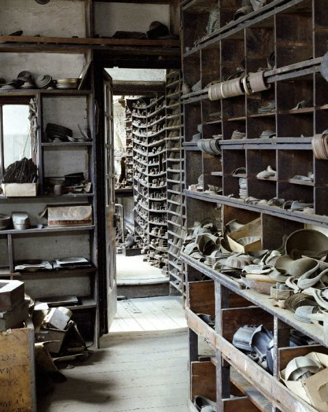 J.W.EVANS, Birmingham, West Midlands. Silversmiths factory. Interior view. Storage shelves along the side of the first floor lobby between the old stock room and fly press room 2 - number 55