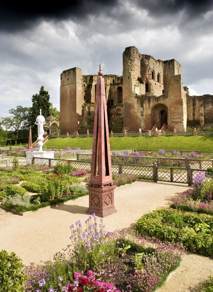KENILWORTH CASTLE, Warwickshire. View across the Elizabethan Garden looking towards the great tower, showing the obelisk and fountain in the foreground. Stormy sky