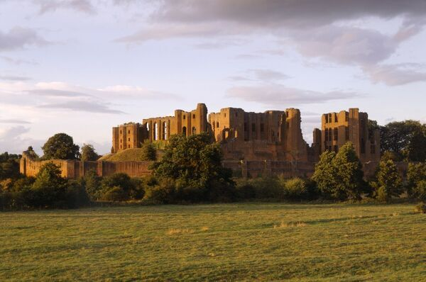 KENILWORTH CASTLE, Warwickshire. General view from the South West at sunset