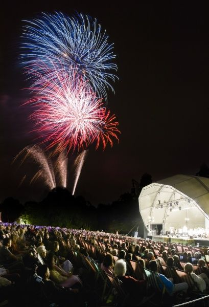 KENWOOD HOUSE, London. Visitors facing the concert bowl watch the fireworks