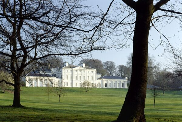 KENWOOD HOUSE, Hampstead, London. Exterior view. The south front viewed through trees, early spring