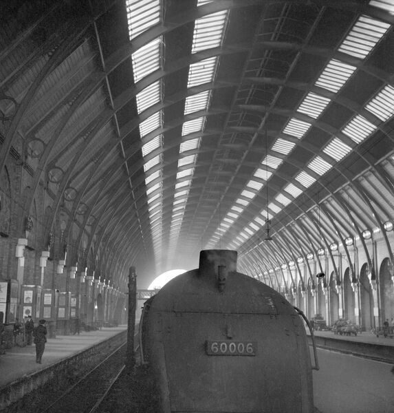 KING'S CROSS STATION, London. The front of steam locomotive engine No. 60006 (The Herring Gull, renamed the Sir Ralph Wedgewood on 6th January, 1944) standing at a platform in Kings Cross Station. 1960-1965, John Gay