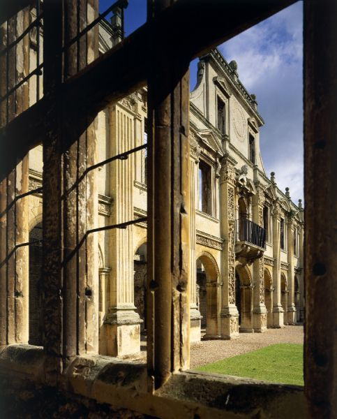 KIRBY HALL, Northamptonshire. View, through window, of North side of the inner court