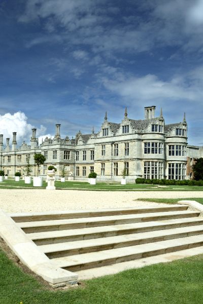 KIRBY HALL, Northamptonshire. General view of house and gardens with steps in foreground