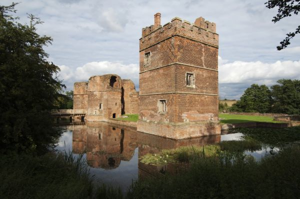 KIRBY MUXLOE CASTLE, Leicestershire. View of the moat looking towards the West Tower and Gatehouse