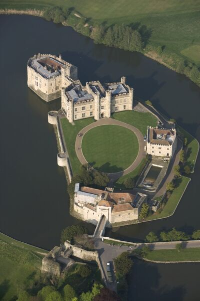 LEEDS CASTLE, Kent. Aerial view. First built in 1119, the castle became a royal palace for Edward I and Eleanor of Castile in 1278, who added the successive gatehouse defences of the barbican. It was later transformed by Henry VIII for Catherine of Aragon