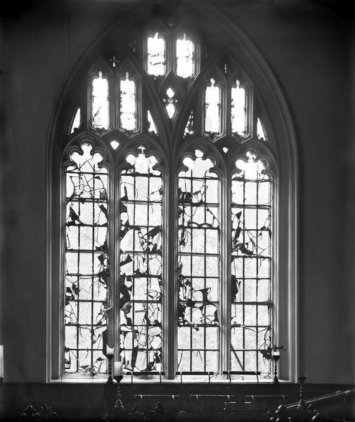 LINCOLNS INN CHAPEL, Holborn, London. Interior view of a shattered stained glass window damaged by a German Zeppelin bomb. Photographed shortly after the bomb fell on 13th October 1915