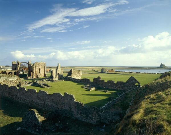 LINDISFARNE PRIORY, Holy Island, Northumberland. General view of the priory and the castle from the south west