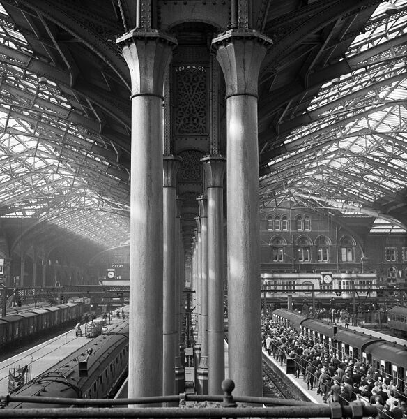 LIVERPOOL STREET STATION, London. Interior view of the station showing the piers of the double aisle and crowded platforms beneath. Photographed by John Gay. Date range: 1960-1972