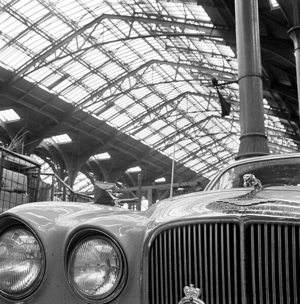 LIVERPOOL STREET STATION. London. Detail of the front of a Jaguar car parked within the station and the station roof in the background. Date range 1960-1972. John Gay