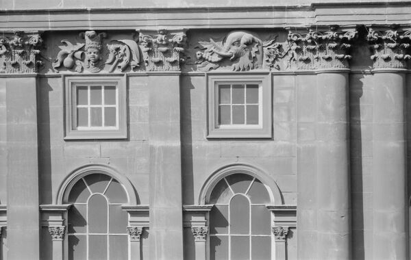 Liverpool Town Hall, Water Street, Liverpool. Detail view showing the upper floor, arched windows and a carved frieze with an elephant. Photographed by Eric de Mare (active 1945-80)