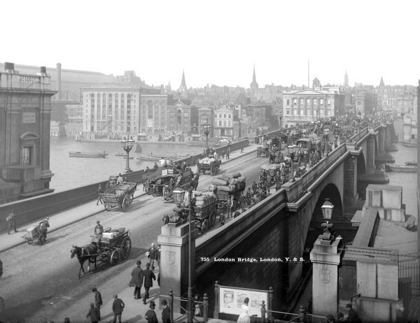 LONDON BRIDGE, City of London. A view looking north-west across a busy London Bridge with horse-drawn traffic and people. The bridge was built between 1823 and 1831. Photographed by York and Son. Date range: 1870-1900