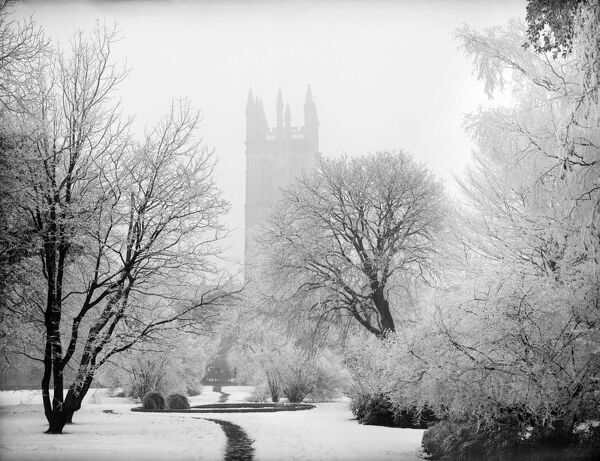 MAGDALEN COLLEGE, Oxford, Oxfordshire. The 15th century Bell Tower taken from the botanic gardens in the snow. Late 19th / early 20th century. Henry Taunt