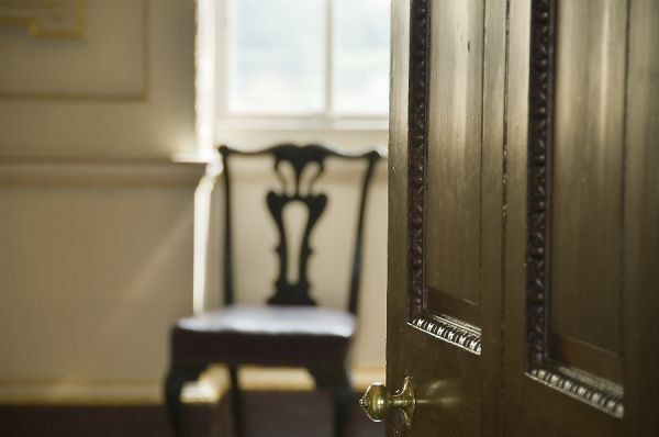 MARBLE HILL HOUSE, Twickenham, Richmond, Middlesex. Interior detail showing door ajar with chair and window beyond