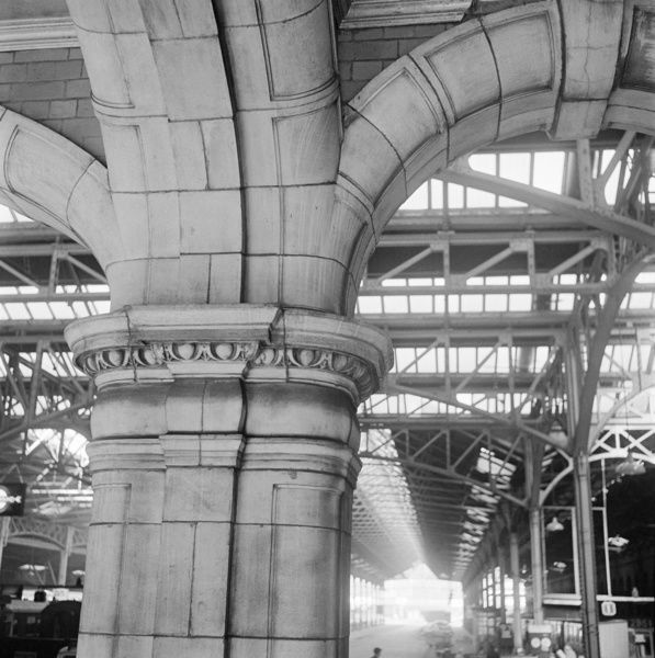 MARYLEBONE STATION, London. Detail of egg and dart decoration on the capital of a terracotta arch at Marylebone station with the interior of the train shed visible beyond. Photographed by John Gay. Date range: 1960-1972
