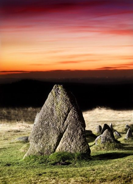MERRIVALE PREHISTORIC SETTLEMENT, Dartmoor, Devon. Illuminated view of the stones at sunset