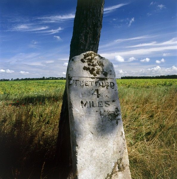 "LANDSCAPE NEAR THETFORD, Norfolk. Detail of milestone inscribed ""Thetford 4 Miles&quot"