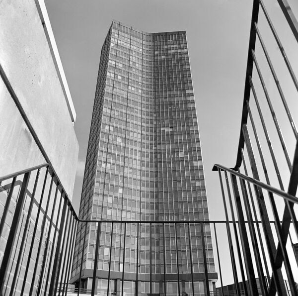VICKERS TOWER, London. The exterior of Vickers Tower, now known as Millbank Tower, seen from behind railings. Photographed by John Gay. Date range: 1963-1969