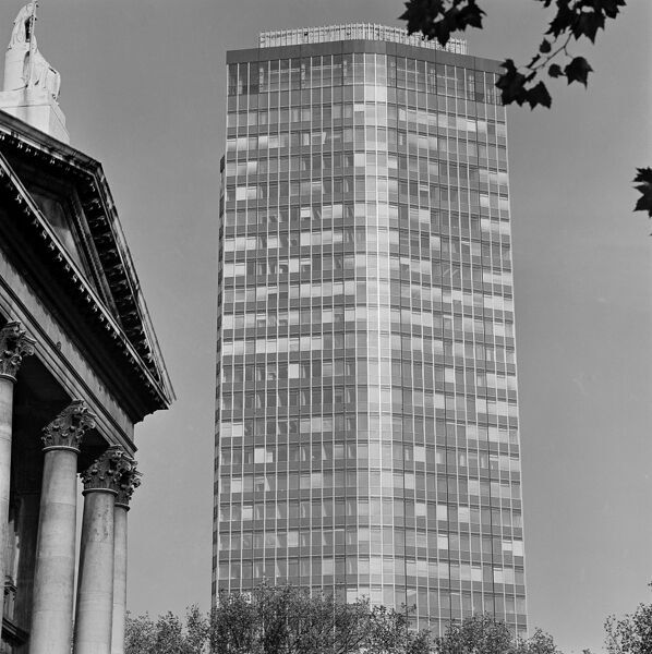 VICKERS TOWER, London. The Vickers Tower, now known as Millbank Tower, with a portico and pediment of the Tate Gallery in the foreground. Photographed by John Gay. Date range 1963-1969