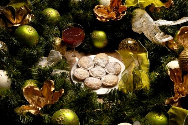 Mince pies, wine and christmas decorations