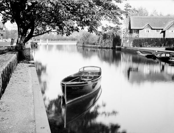 RIVER THAMES, Oxfordshire. Boat moored on the river, perhaps near a lock or weir. This picturesque view shows a boat called the 'Wei-ha-Wei' moored in the foreground. Photographed by Henry Taunt (active 1860 - 1922)