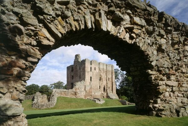 NORHAM CASTLE, Northumberland. The keep and inner ward from the south-west, seen through the south curtain wall of the outer ward