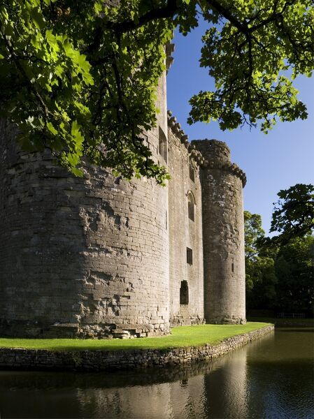 NUNNEY CASTLE, Somerset. View of the 14th century French style castle and moat
