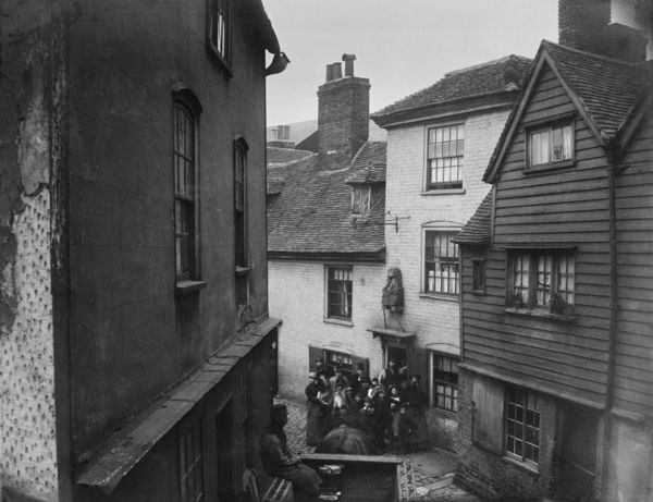 George Lane, Rochester, Kent. An elevated view showing a group of people outside The Old Parrs Head public house. Photographed between 1862 and 1867. Reproduced from a Gordon Barnes copy negative