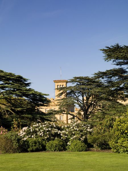 OSBORNE HOUSE, Isle of Wight. General view from the gardens, through the trees, towards the house