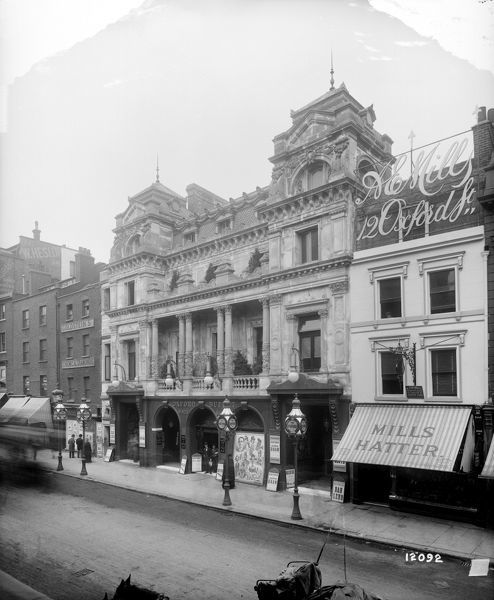 THE OXFORD MUSIC HALL, Oxford Street, Westminster, London. The Oxford Music Hall on the north side of Oxford Street between A. E. Mills (the Hatter) and Goldstein's Chemical Diamonds was demolished in 1926. It was opened in 1861 by Charles Morton