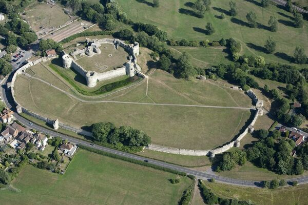 PEVENSEY CASTLE, East Sussex. Aerial view of the castle showing the medieval inner bailey and the larger Roman enclosure