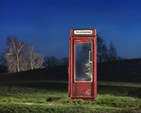 K8 Telephone Kiosk, Langton Park, Wroughton, Swindon, Wiltshire. General view, lit at twilight, of a K8 telephone box, designed by Bruce Martin in1965