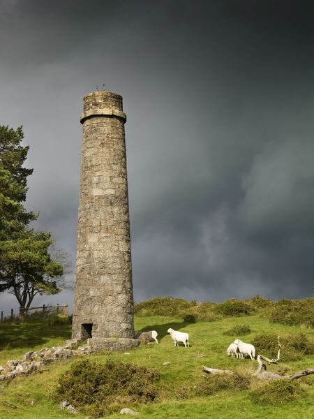 DARTMOOR, Devon. One of the Postbridge Powder Mills chimneys against an overcast sky