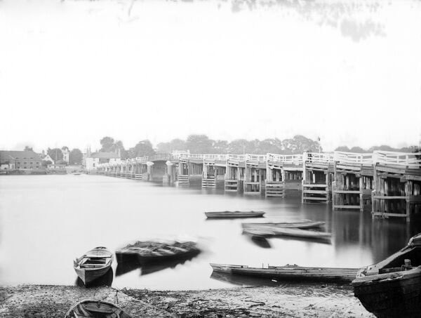 PUTNEY OLD BRIDGE, Putney, Greater London. Exterior view of the old timber bridge looking across river from Putney. This bridge, rebuilt in stone in 1884-6 was once a notorious place for duels. Photographed by Henry Taunt in 1875