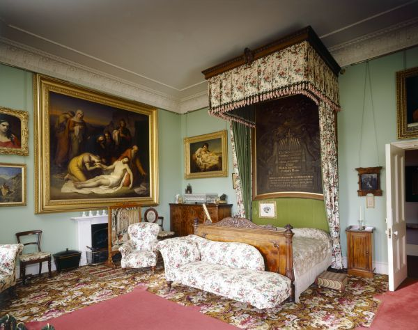 OSBORNE HOUSE, Isle of Wight. Interior view of Queen Victoria's Bedroom looking toward the bed. Some items shown maybe on loan from the Royal Collection