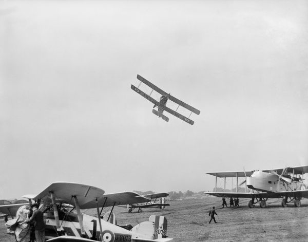 HENDON, Barnet. An Avro 504 aircraft flying very low over parked aircraft at the RAF Pageant of 1927